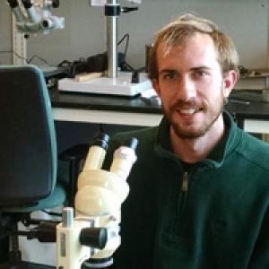 Matt Grasso with microscope