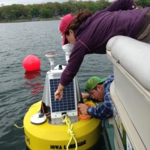 Researchers working on equipment on lake