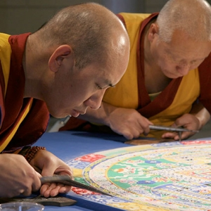 Buddhist monks create a sand mandala in the Marble Court