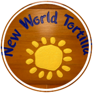new world tortilla's logo on a wood engraved wall