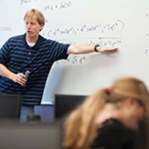 A faculty member gives a lecture
