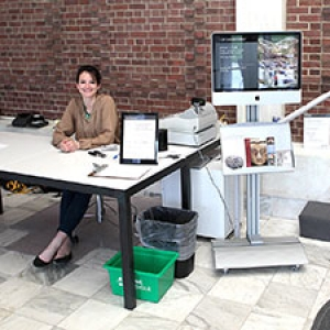 UVM student working at the front desk