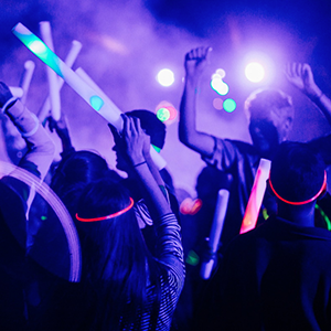 students dancing at a glow party