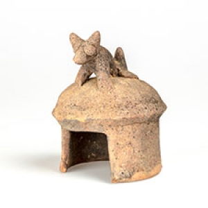 Miniature model house with dog on roof