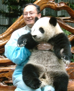 Dr. Zhao holding a panda in a zoo