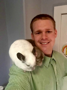 A.J. with his two pet chinchillas