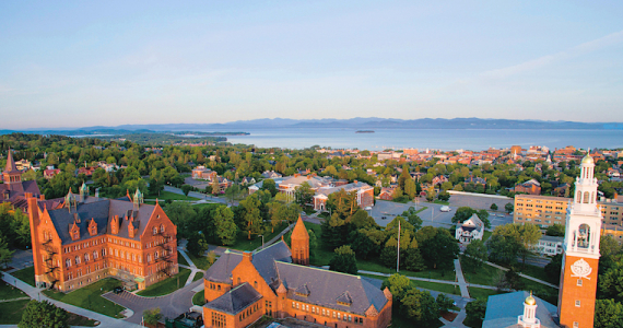 Aerial view of UVM campus, Lake Champlain, and the Adirondack Mountains in the distance