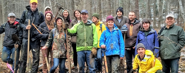Group of students and faculty in the woods