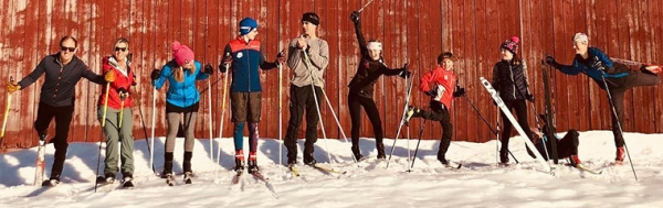 Nordic skiers next to barn. Photo credit: Kingdom Trails Association