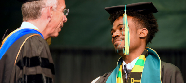Robert Parris ('17) receiving is diploma from Dean Thomas.