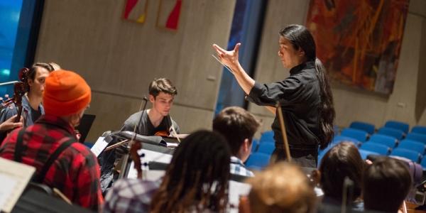 Kono conducts the orchestra