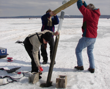 students conducting research on frozen lake
