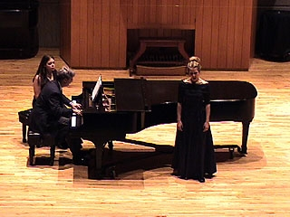 A vocalist performs with piano accompaniment