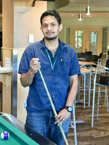 student holding a pool que