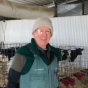 Dr. Wadsworth at a farm with dairy cows