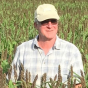 vern grubinger in a field of millett