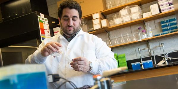 Amiel working in his laboratory