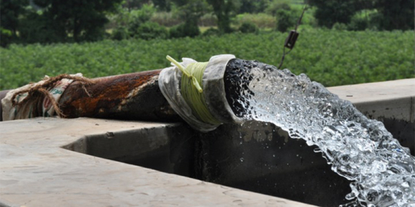 Water is pumped from a deep irrigation well, called a tube well, at a wheat farm in India's Gujarat state.