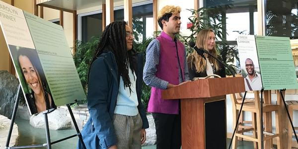Students Cat Lawrence, Kunal Palawat, and Kirsti Carr at podium