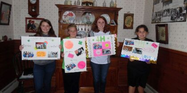 Members of the Border Livestock 4-H Club in Derby made posters as part of the National 4-H Week Challenge