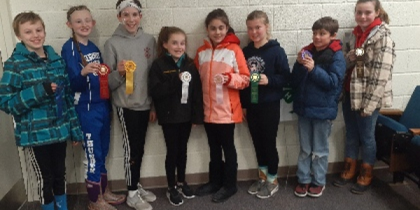 Eight students holding ribbons