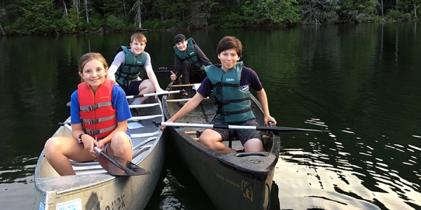Four youth in two canoes