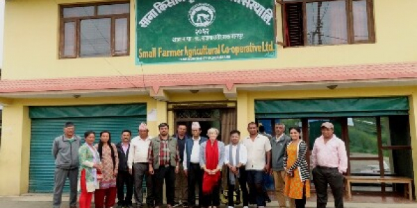 Dr. Ann Hazelrigg gathers with a group of Nepali farmers
