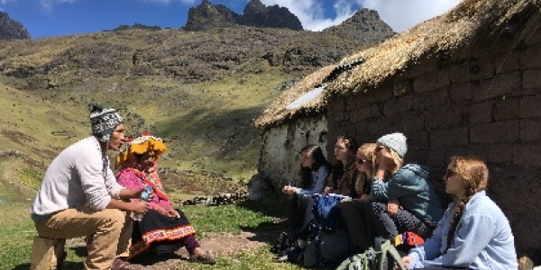 Students from CDAE 171 engaging with community members in Peru