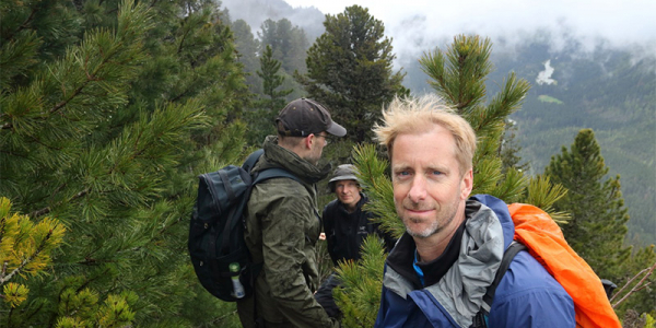 Three scientists in mountain forest