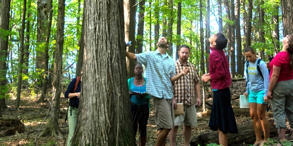 Matt Kolan and students in forest at Shelburne Farms