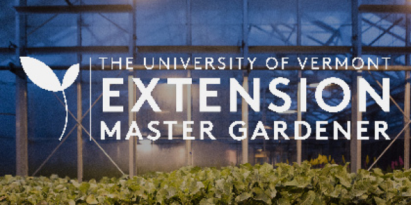 Master Gardener logo posted on plants in a green house