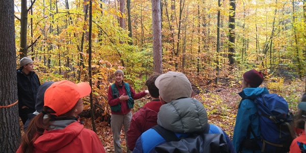 Forestry students in woods with Vermont County Forester.