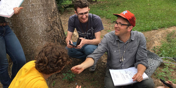 students and professor working with plants