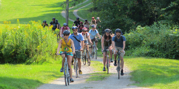 Students biking on Vermont dirt road