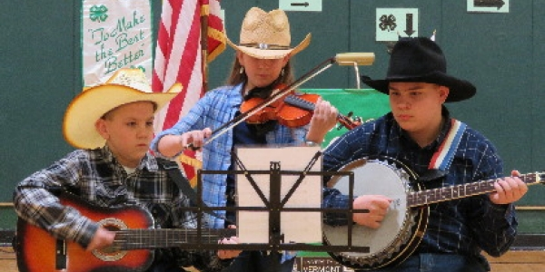 Kids performing in a band