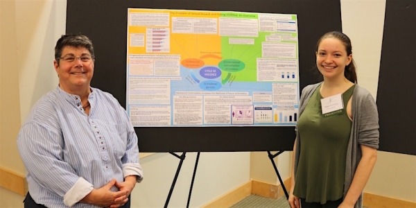 At the UVM Student Research Conference, Shaya Ginsberg (right) with her project advisor JB Barna, senior lecturer in the Department of Social Work at UVM.