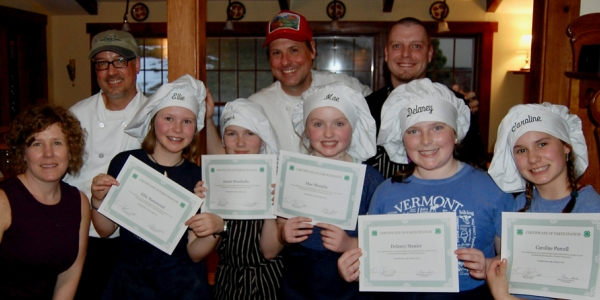 Students pose with certificates and Tucker Hill Inn staff