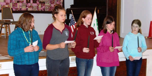 5 4-H members with candles