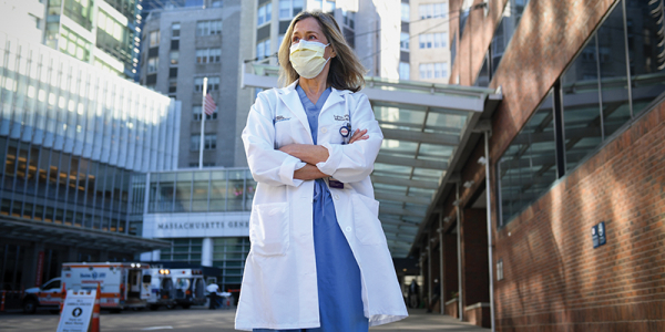 Dr. Lynn Black in surgical scrubs outside Massachusettes General hospital.