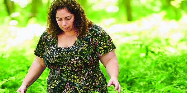 Melody Walker walking through a fern forest