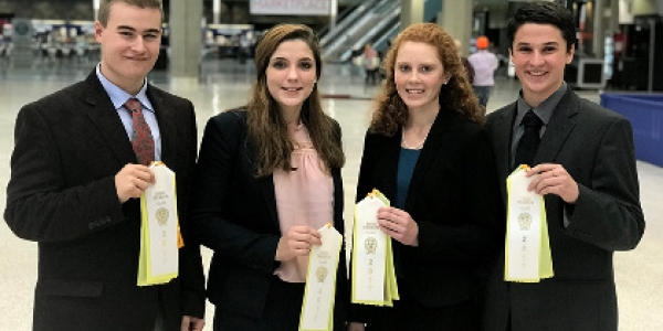Four Vermont teens had an opportunity to compete at the National Youth Dairy Judging Contest, Nov. 5, in Louisville, Kentucky. From left: Joseph Real, Georgia; Maddie Nadeau, Derby; Isabel Hall, East Montpelier; and Seth Carson, Newbury. (photo: courtesy
