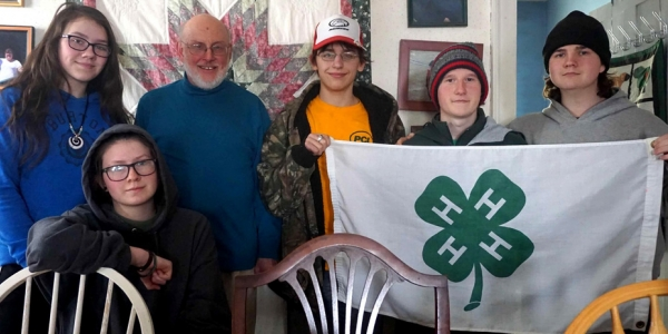 4-H club members stand together