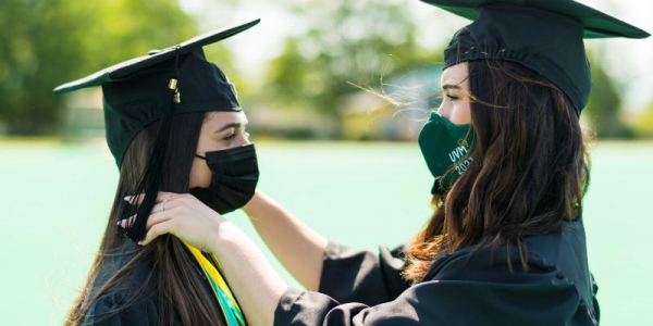 Friends congratulate each other on commencement