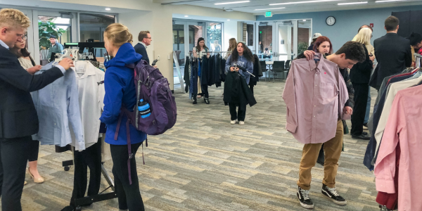 Students browsing the 2019 Dress for Success event (Photo: Rachel Narkewicz)