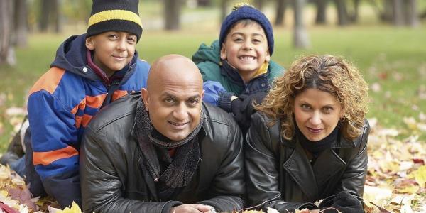 family in fallen leaves