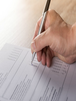 Image of a hand completing a survey