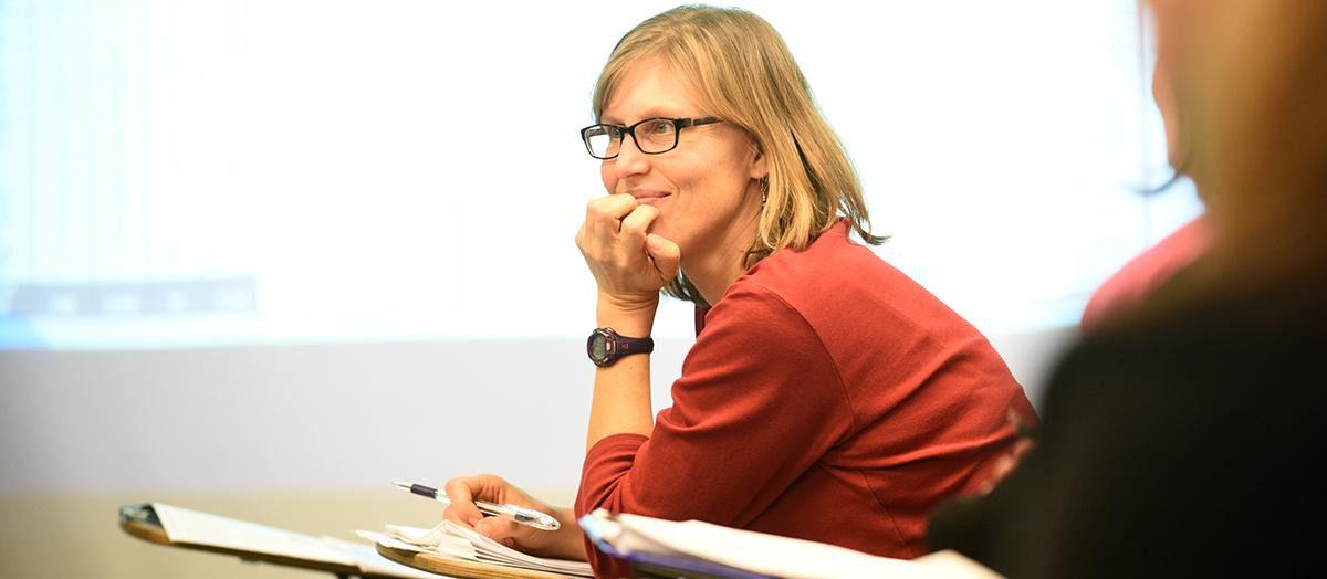 Professor Tammy Kolbe sits in a classroom