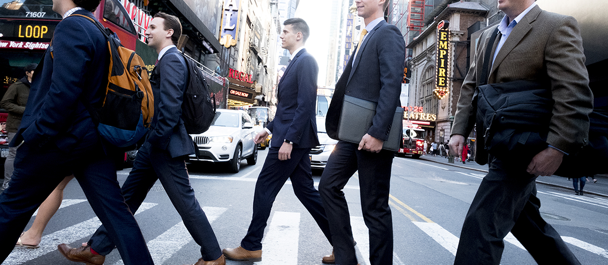 Business students walk in New York City by Mario Morgado