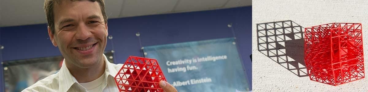 Professor Greg Warrington holding a 3d printed object