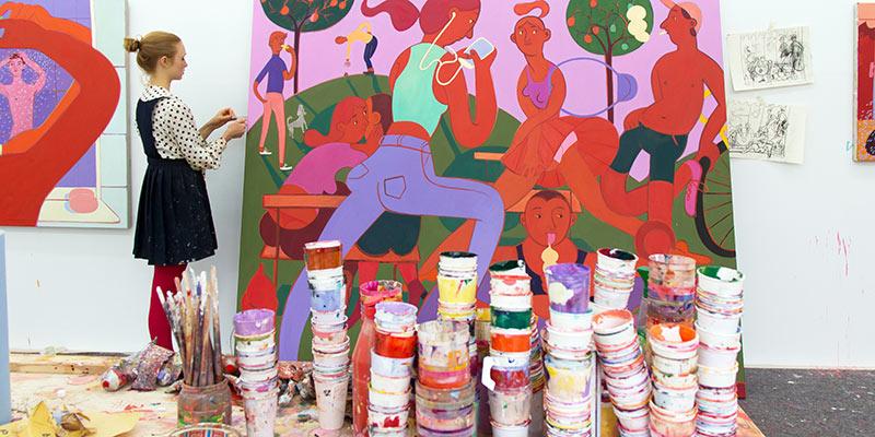 Grace Weaver painting in her studio